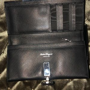 New black with silver logo wallet. Leather good